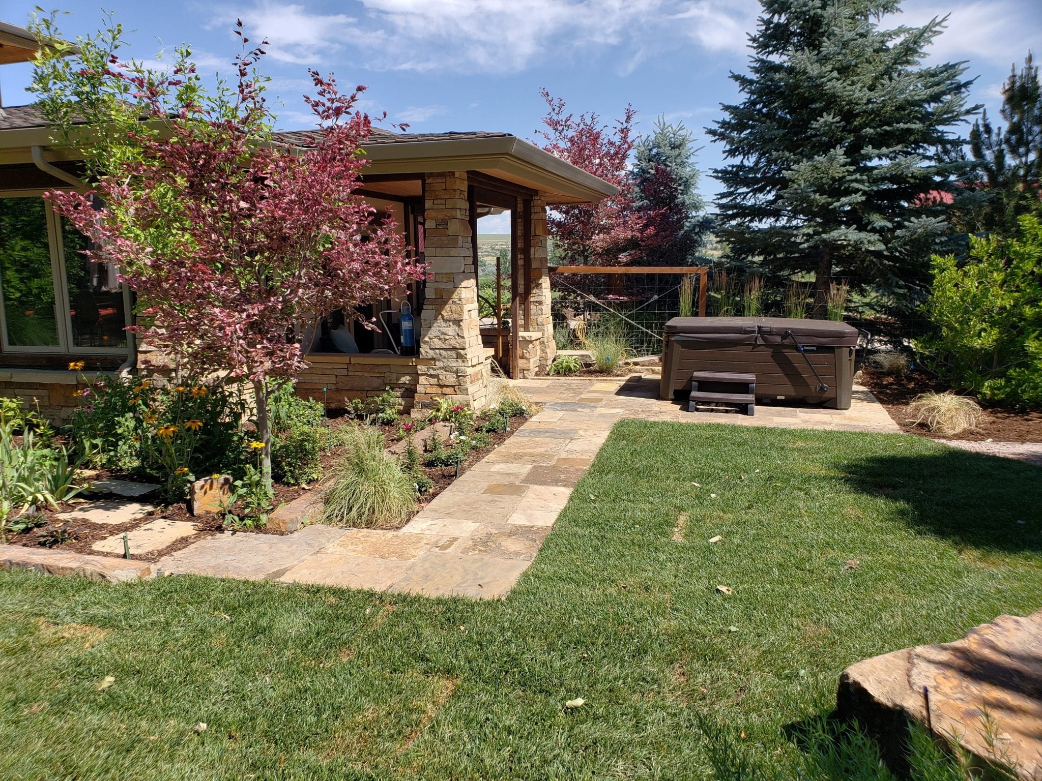 hot tub patio pathway perennial garden