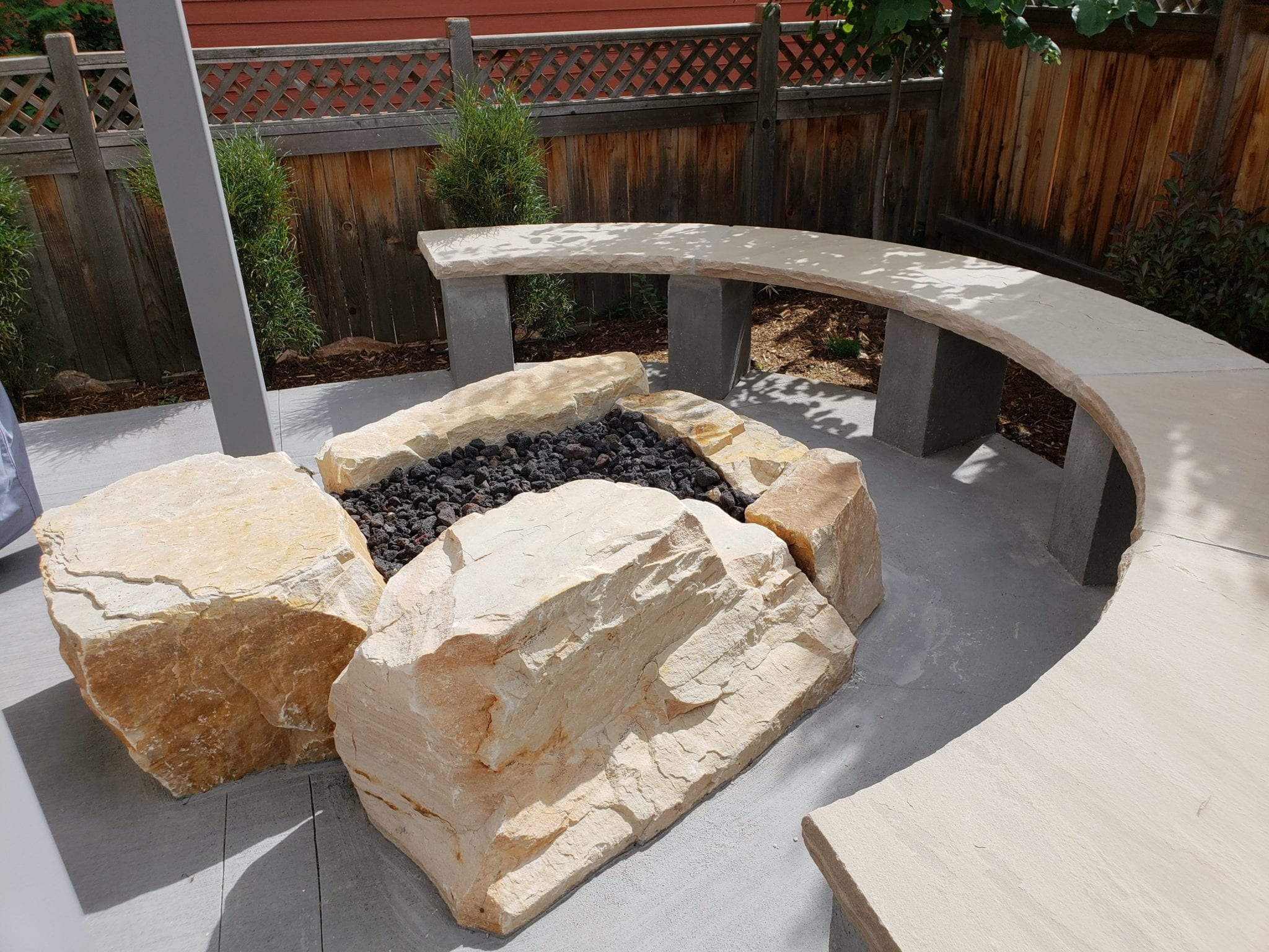 blond boulder fire pit with bench seating