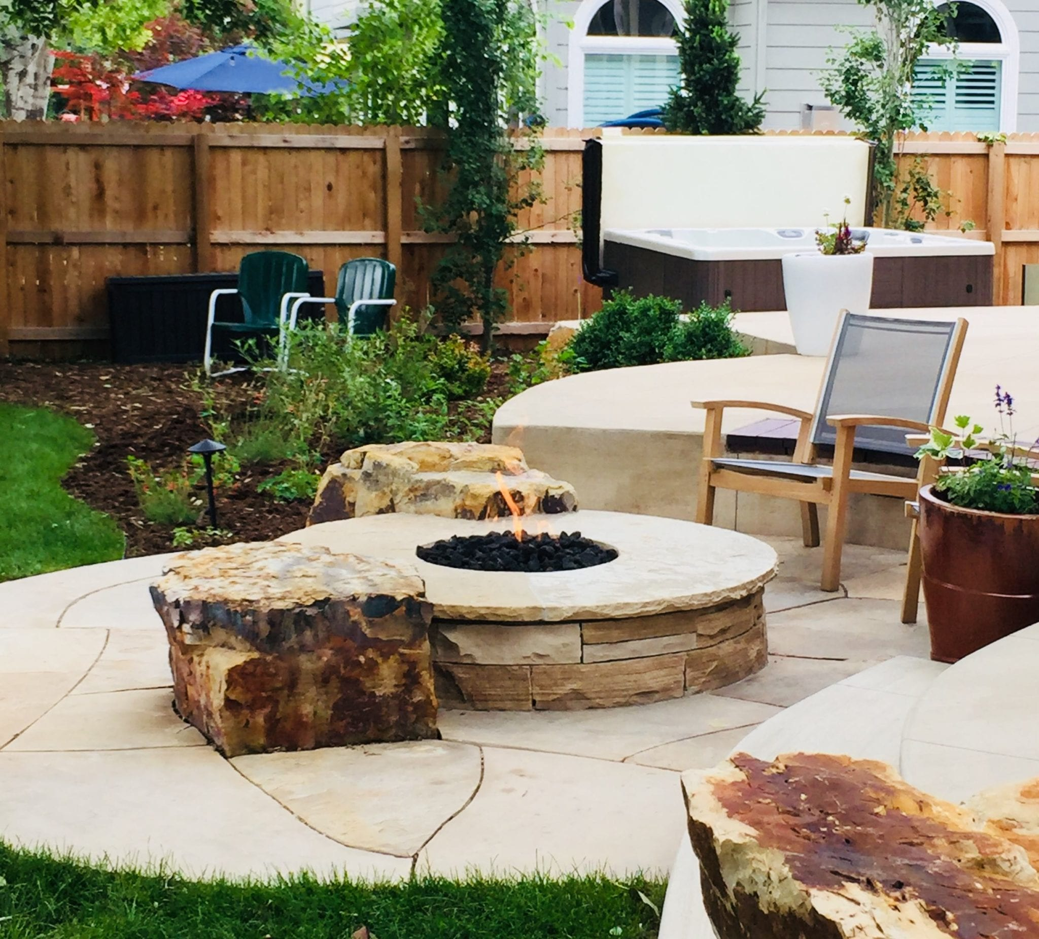 circular fire pit with boulder accents