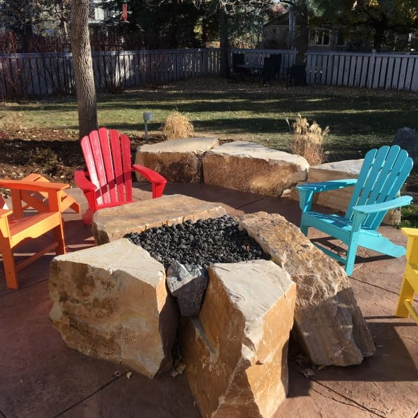 Fire pit boulders with colored concrete patio