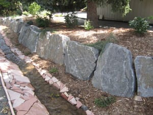 Foold mitigation berm with boulder wall