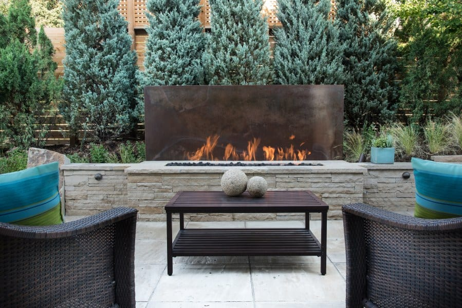 modern fire pit with steel backdrop