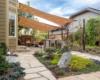 Rock garden shade sails outdoor kitchen Ecoscape