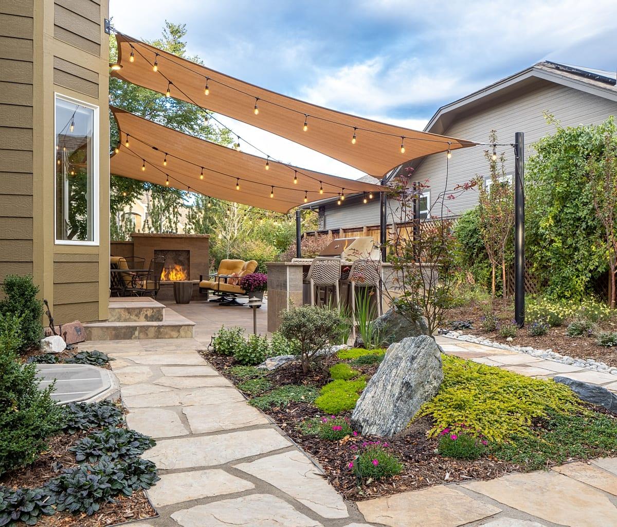 Rock garden shade sails outdoor kitchen